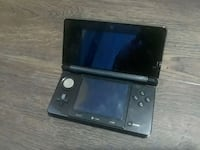 black Nintendo 3DS with game cartridge Martensville, S0K 0A2