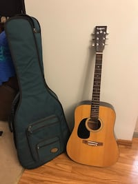 brown dreadnought acoustic guitar with gig bag Waynesville, 65583