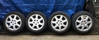 Set of 4 Winter Tires 205/55R16 in Cadillac Alloy Rims Burnaby, V3N 4J8