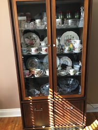 Dining Room Table and Four Chairs in good condition plus glass doors and shelves hutch ! Good condition