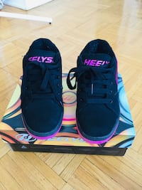 Pair of pink and black heelys Toronto, M3H 2R6