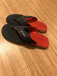 Black and red flip flops
