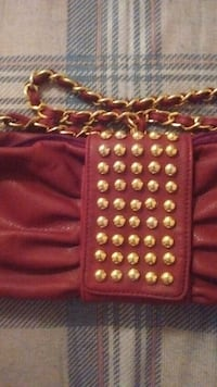 red leather studded purse Price, 84501