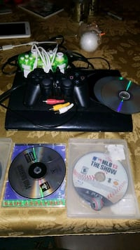 PS3 with 9 games 2 controllers