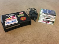 Black xbox 360 with game cases Jacksonville, 28540