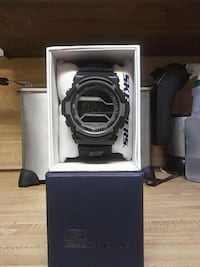 round gray and black digital watch with box