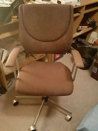 brown wooden framed gray padded armchair