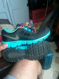 pair of blue-and-black Nike running shoes Palm Harbor, 34684