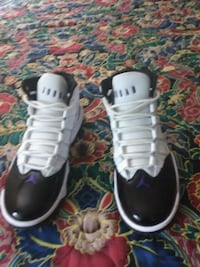 pair of black-and-white Nike basketball shoes 54 mi