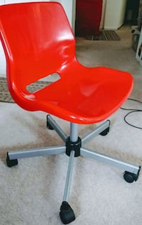 1 Ikea red desk chair on wheels