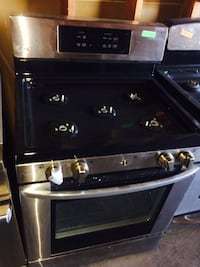 stainless steel and black LG gas range oven