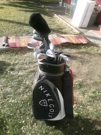 black and gray golf bag with golf clubs Calgary, T2A 1J2