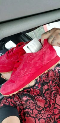 pair of red suede high-top sneakers Surrey, V3T 1H9