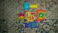toddler's yellow and blue plastic toys