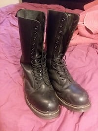 pair of black Dr. Martens leather combat boots