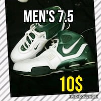 white-and-green Nike Air Max shoes 856 mi