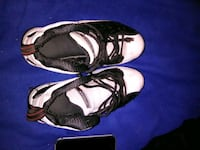 pair of black-and-white Nike basketball shoes 1456 mi