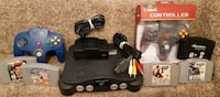 Nintendo N64 System with Goldeneye 5 games  Games cleaned and tested and titles are: -  Goldeneye 007 -  Star Wars Rogue Squadron -  NHL 99 -  Nascar 99 -  Wrestlemania  Complete N64 system tested and in working order comes with  N64 Black console with st Newmarket