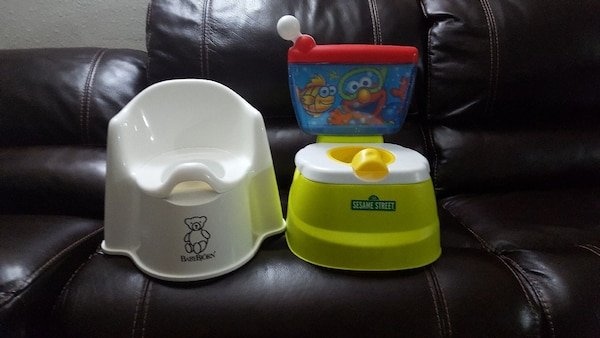 Babys white and green potty chairs.