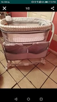baby's gray and white bassinet