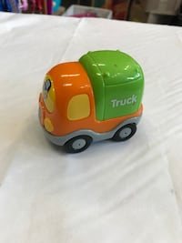 orange and green plastic truck toy