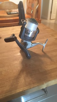 black and grey fishing reel