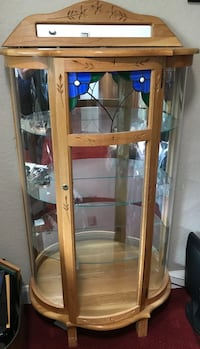 Oak, glass, lifted and mirrored cabinet with 3 glass shelves. Coral Springs, 33067