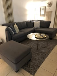 Black fabric sectional sofa with ottoman Coral Gables, 33134