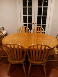 round brown wooden table with six chairs dining s 30 km