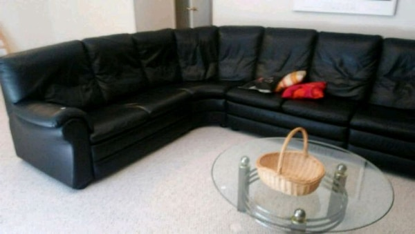 Huge Black Leather Sectional Glass table included