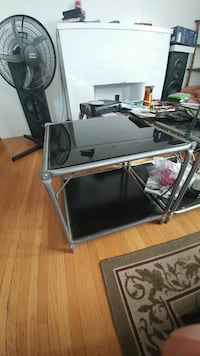 square black tinted glass-top 2-tier coffee table and black pedestal fan Edmonton, T6E 0X4