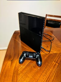 Used PS4 console and controller- games included- great condition Centreville