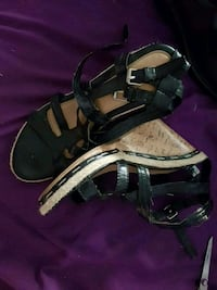 pair of black leather open-toe ankle strap heels 1957 km
