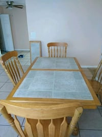 brown wooden table with four chairs 775 mi