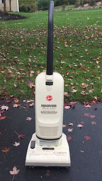 white and black Hoover vacuum cleaner