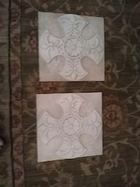 two gray-and-white floral cross printed decors