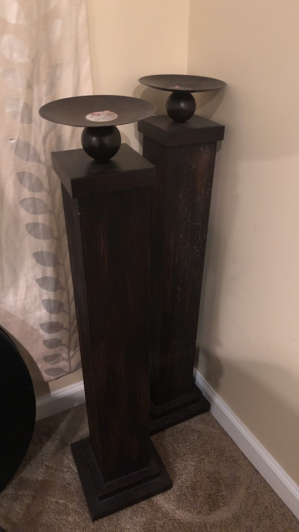brown wooden pillar base candle holders