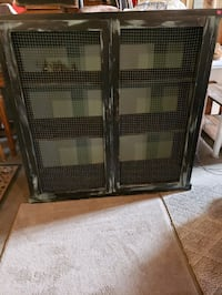 "Cabinet. 3 shelves chicken wire front 43"" long 42"" tall 14 depth"