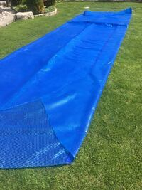 Dark blue solar blanket  for a 16 x 26 oval pool size with pole to wind up blanket Richmond Hill, L4E