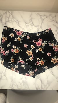 women's black, pink, white, and beige floral shorts