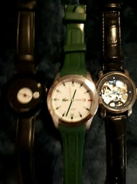 two round gold analog watches with black leather straps Ajax, L1Z
