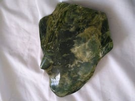 green and brown stone fragment