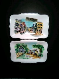 two white-and-green ceramic decorative plates