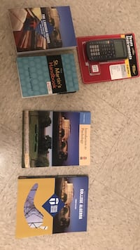 four assorted labeled textbooks