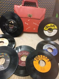 45 RPM records with Red Carrying Case