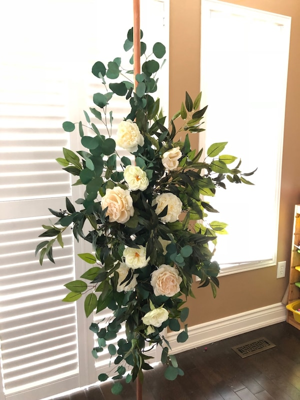 Rental arch with artificial flowers and greenery  c2947c0b-7d79-4ff6-8462-3483512cdd92