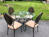 Round glass top table with four chairs dining set Inwood, 25428