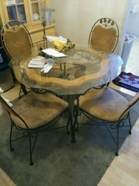 brown wooden table with chairs El Paso, 79930