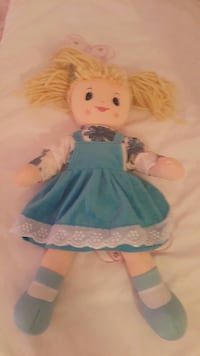 blonde-haired female doll in blue dress