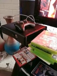black Xbox 360 console with controller and game ca Las Vegas, 89119